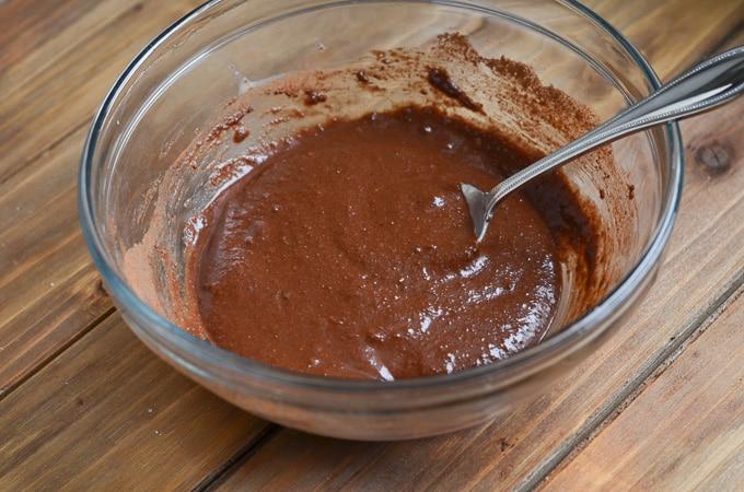 Ingredients for Paleo chocolate mug cake in mixing bowl.