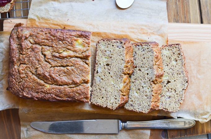 Banana bread on cutting board with slices.