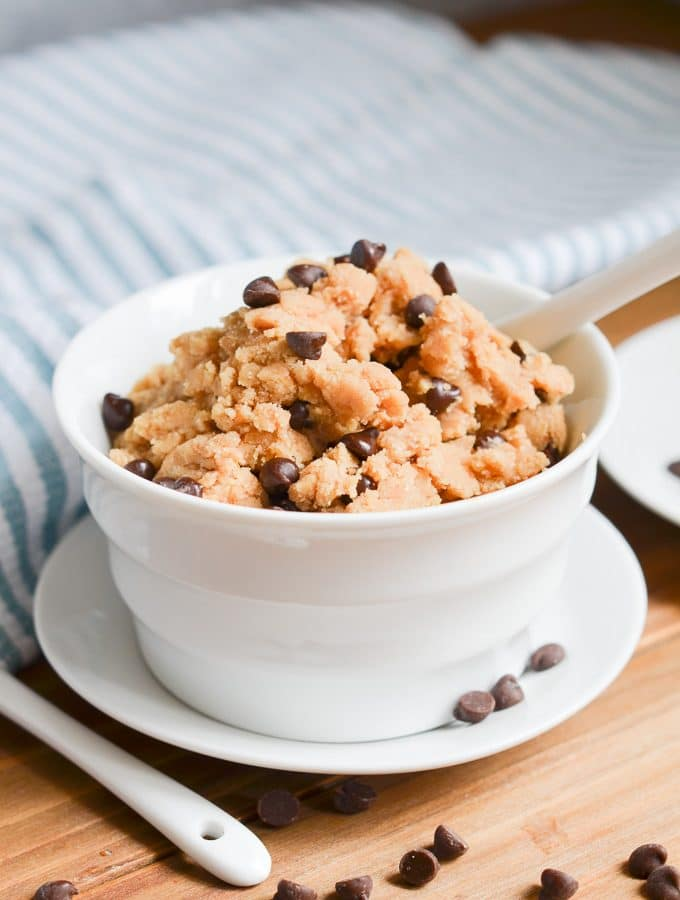 edible cookie dough in bowl with spoon.