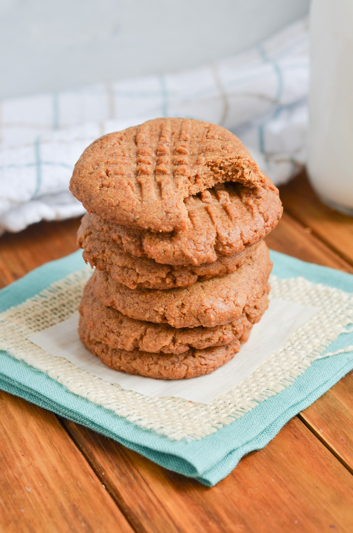 peanut butter cookies in a stack on a napkin.