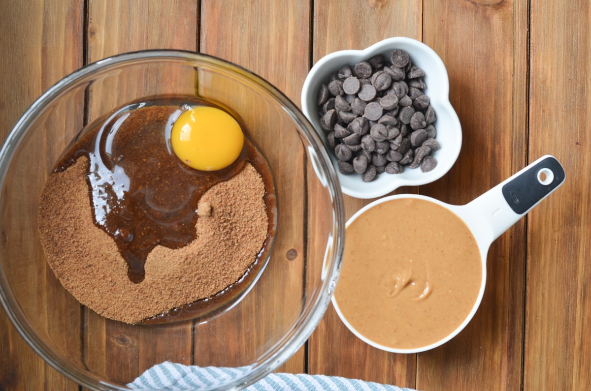 ingredients for peanut butter chocolate chip cookies on counter.